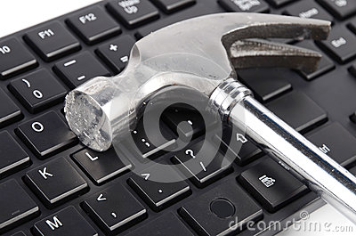 Computer keyboard and hammer