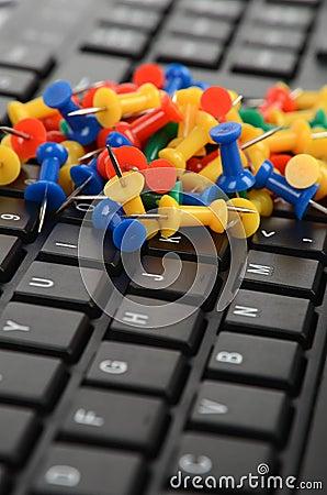 Computer keyboard and push pin
