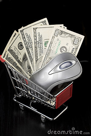 Computer mouse and $100 dollar bills in a shopping