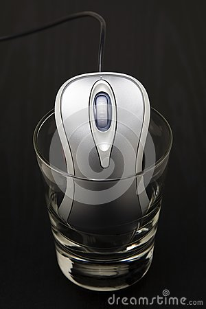 Computer mouse in a glass