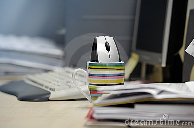 Computer mouse inside a mug