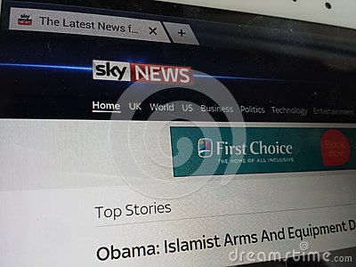 Computer screen showing sky news front page on internet