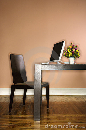 Computer on Table with Flowers