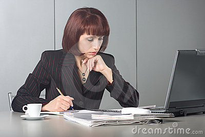 The concentrated beautiful business woman