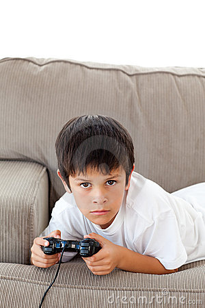 Concentrated boy playing video games