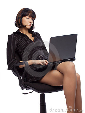 Concentrated brunette woman in dark dress sitting