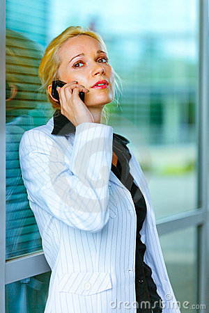 Concentrated business woman talking on mobile