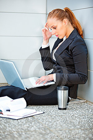 Concentrated business woman using laptop