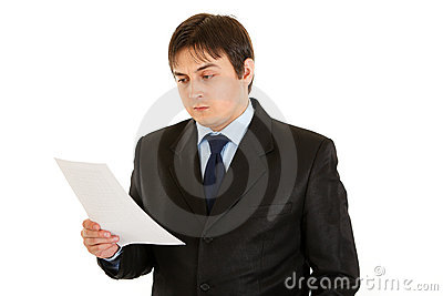 Concentrated businessman checking document