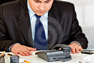 Concentrated businessman expecting phone call