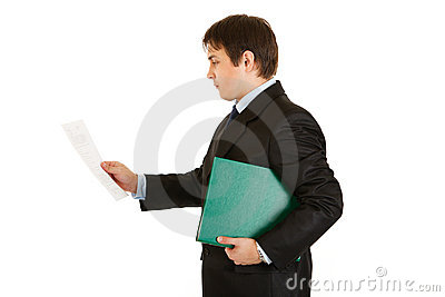 Concentrated businessman with folder