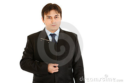 Concentrated businessman holding clipboard in hand