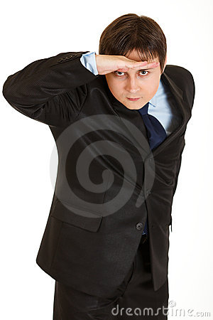Concentrated businessman holding hand at forehead