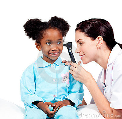 Concentrated doctor checking her patient s ears