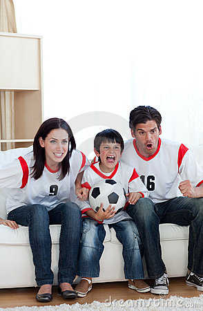 Concentrated family watching football match on tv