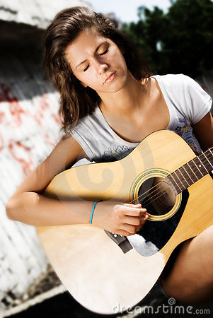 Concentrated girl, playing guitar