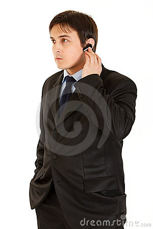 Concentrated modern businessman with handsfree