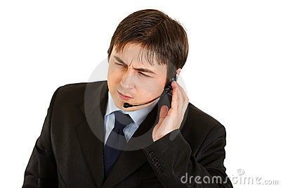 Concentrated modern businessman with headset