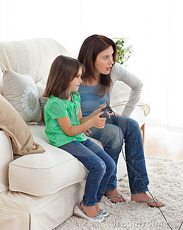 Concentrated mom and daughter playing video games