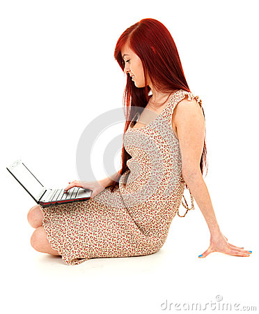 Concentrated teenage girl using laptop