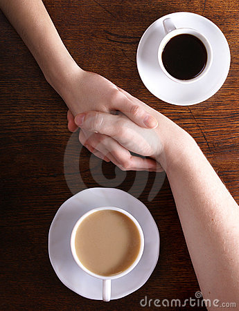Concept image of two bonded hands and coffee