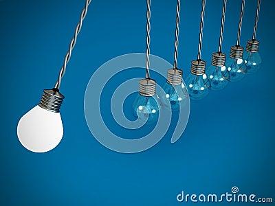 Concept teamwork pendulum from bulbs on blue