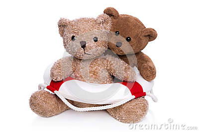 Concept teamwork - teddy bears with lifebelt.