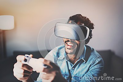 Concept of technology,gaming,entertainment and people.African man playing virtual reality glasses video game while Stock Photo