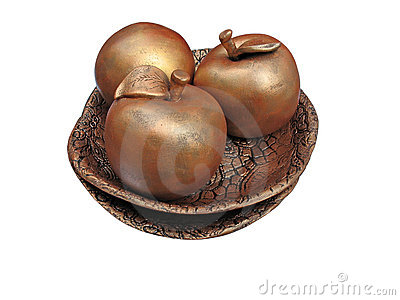 Concept of three bronze apples on a plate isolated