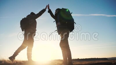 Concept victory teamwork achievement goal slow motion video business concept. two tourists meet on top of a mountain. With backpacks shake hands. lifestyle stock video