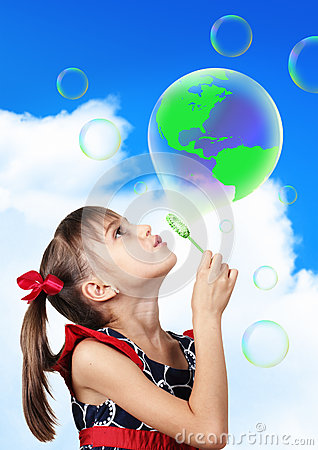 Free Conceptual Image, Child Girl Blowing Soap Bubble Forming Green G Stock Photo - 58554890