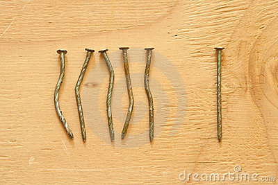 Conceptual image of crooked and straight nails