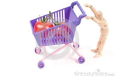 Conceptual photo with wooden man and shopping-cart