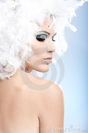 Conceptual portrait of woman in winter makeup