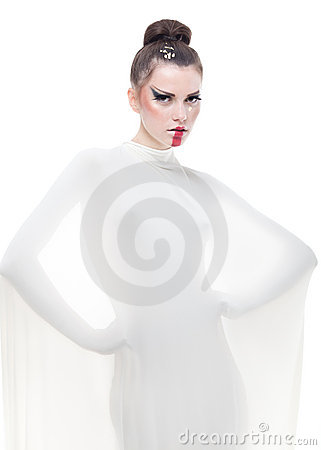 Conceptual portrait young woman dressed in white.