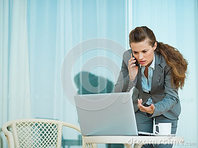 Concerned business woman speaking mobile