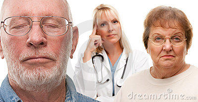 Concerned Senior Couple and Female Doctor Behind