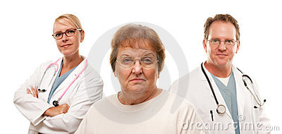 Concerned Senior Woman with Doctors Behind