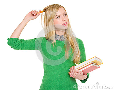 Concerned student girl with books