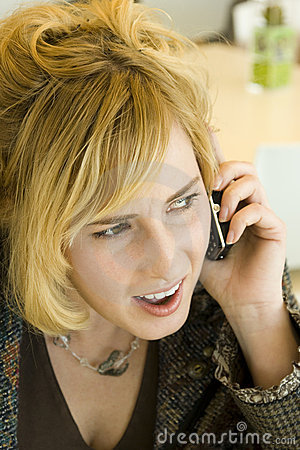 Concerned Young Blonde Woman on Mobile Phone