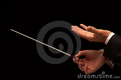 Concert conductor hands with baton