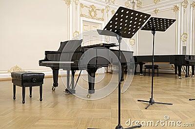 Concert grand piano on a scene.