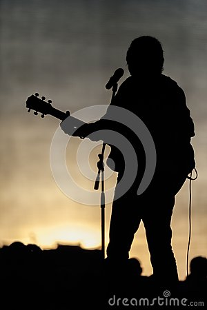 Concert stage and musician silhouette