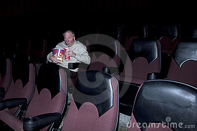 Man Enjoying Concessions in Movie Theater