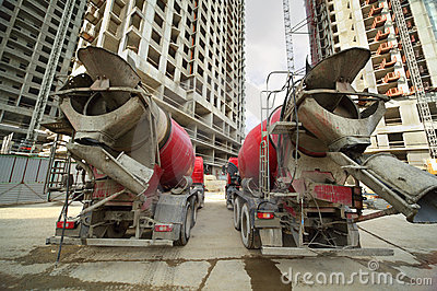 Concrete mixer stand near unfinished building Stock Photo