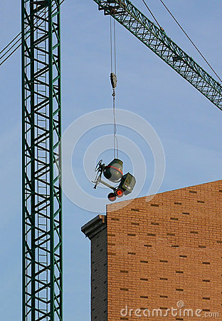 Concrete-mixer suspended from a crane