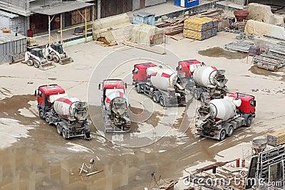Concrete mixers, tractor, construction materials