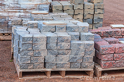 Stacks Of Various Colored Concrete Pavers (paving Stone) Or Patio Blocks  Organized On Pallets And For Sale Stock Photo - Image: 67207601 - Stacks Of Various Colored Concrete Pavers (paving Stone) Or Patio