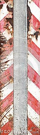 Concrete pillar with warning stripes