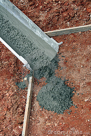 Concrete truck pouring cement